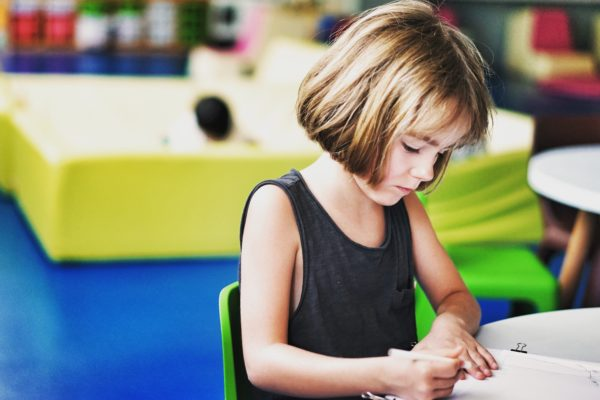 A girl making drawing